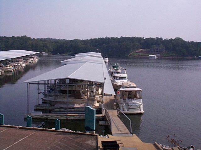 Transient boats line the outside of Pier H at Aqua Yacht Harbor, Iuka, MS
