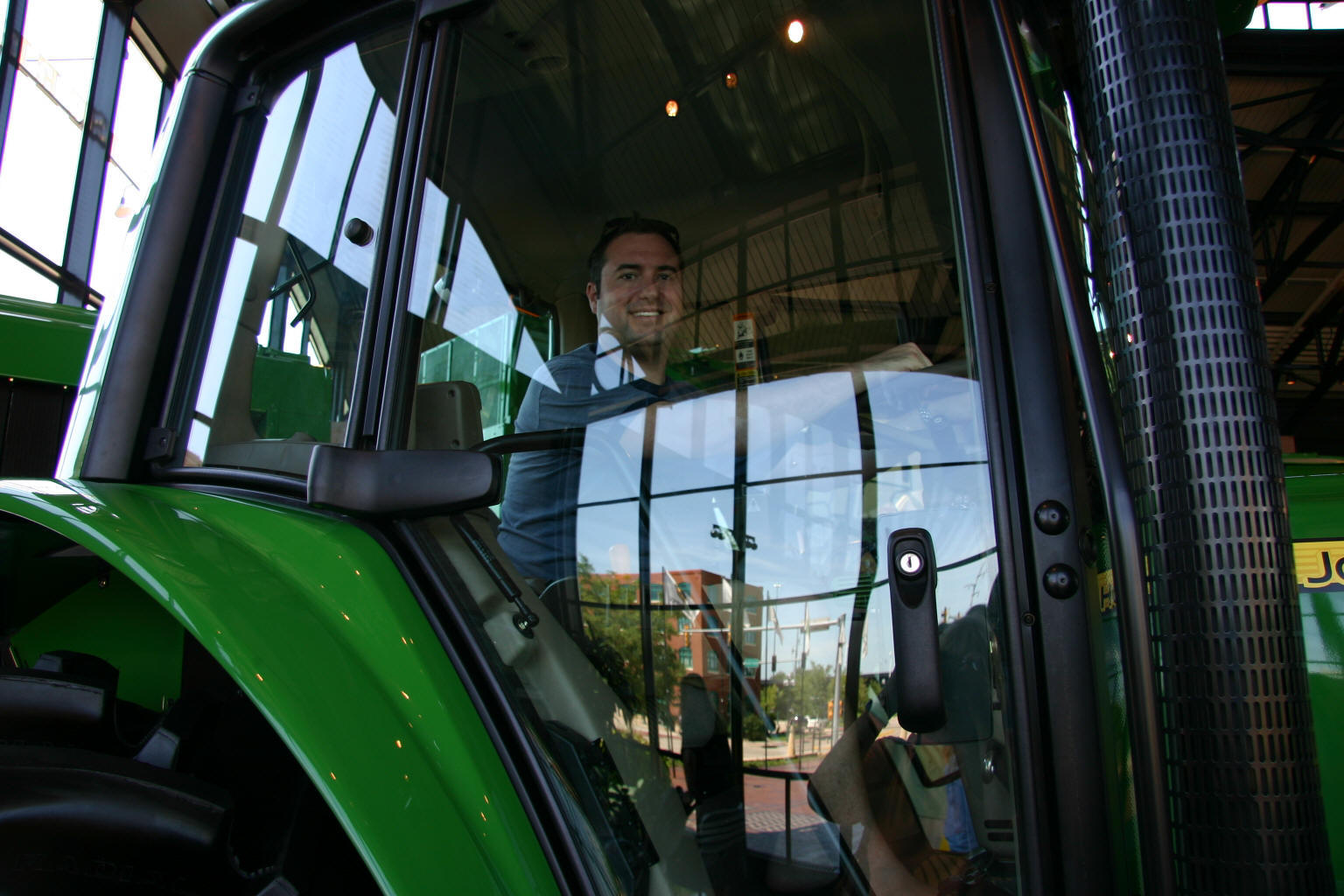 Farmer Jon plays with the tractors